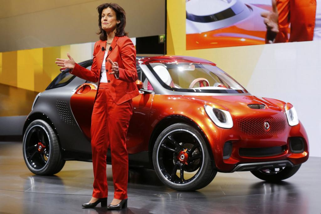 Annette Winkler, head of Smart brand on stage with a Smart ForStars model at the Paris Motor Show.