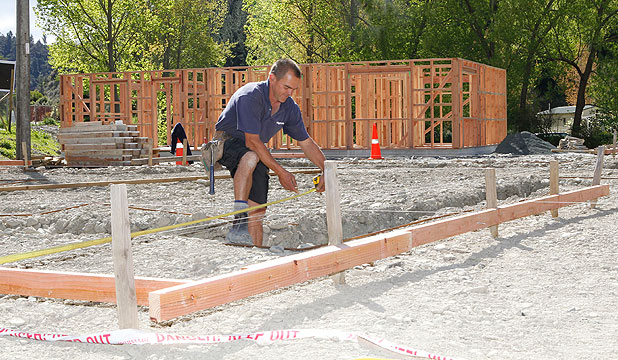 ON SOLID GROUND: Roger McLean, contractor for Hybrid Homes sets up the foundations for one of the Nelson Tasman Housing Trust's projects developing affordable rental accommodation project at the Brook St site.