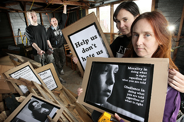 WELFARE WOES: Leah Gilbert (right) and sister, Sarah Gilbert with sign-making helpers Jeremy Greenfield and Rob Birtles, preparing for the Hamilton branch of National Day of Action against welfare reforms on Friday.