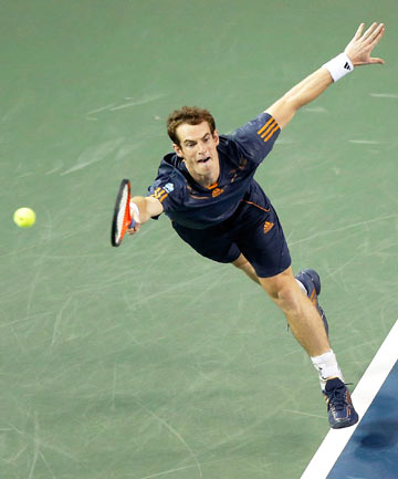 REACHING OUT: Andy Murray reaches unsuccessfully for a serve from Ivo Karlovic during his first round victory at the Japan Open.