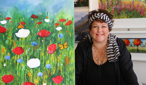 FLOWER POWER: Arrowtown-based artist Bridget Paape and one of her colourful works.