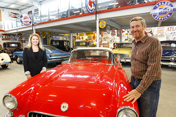 VINTAGE VEHICLES: Tom Andrews and daughter Emily show off the 1957 Chevrolet Corvette, one of 100 cars on display at the Classics Museum, opening soon.