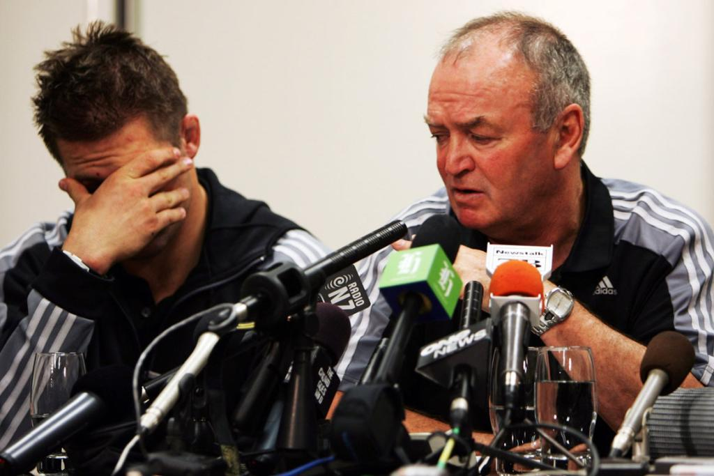 All Blacks captain Richie McCaw and then coach Graham Henry front the media at a press conference after the team arrived home following their defeat to France in the 2007 Rugby World Cup quarterfinal.