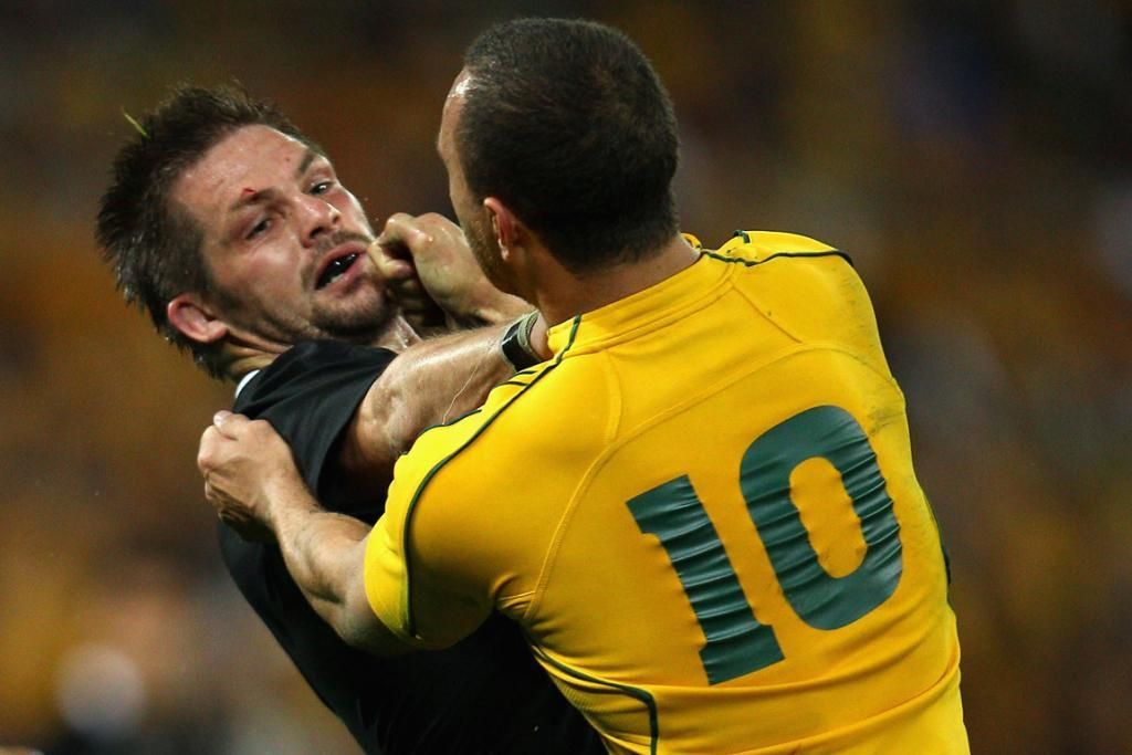 All Blacks captain Richie McCaw and Wallabies first five-eighth Quade Cooper square off in 2011.
