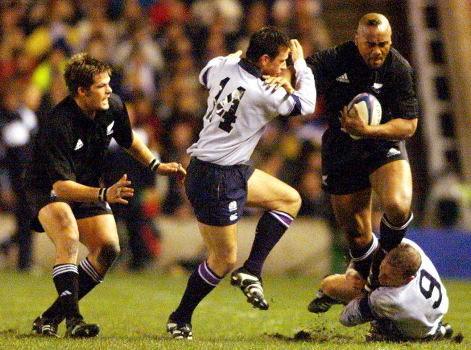 Scotland's Jon Steel, left, and Andy Nicol, right, hang onto Jonah Lomu as Richie McCaw watches on. The game at Murrayfield Stadium in Edinburgh was part of McCaw's first All Blacks tour, in 2001.