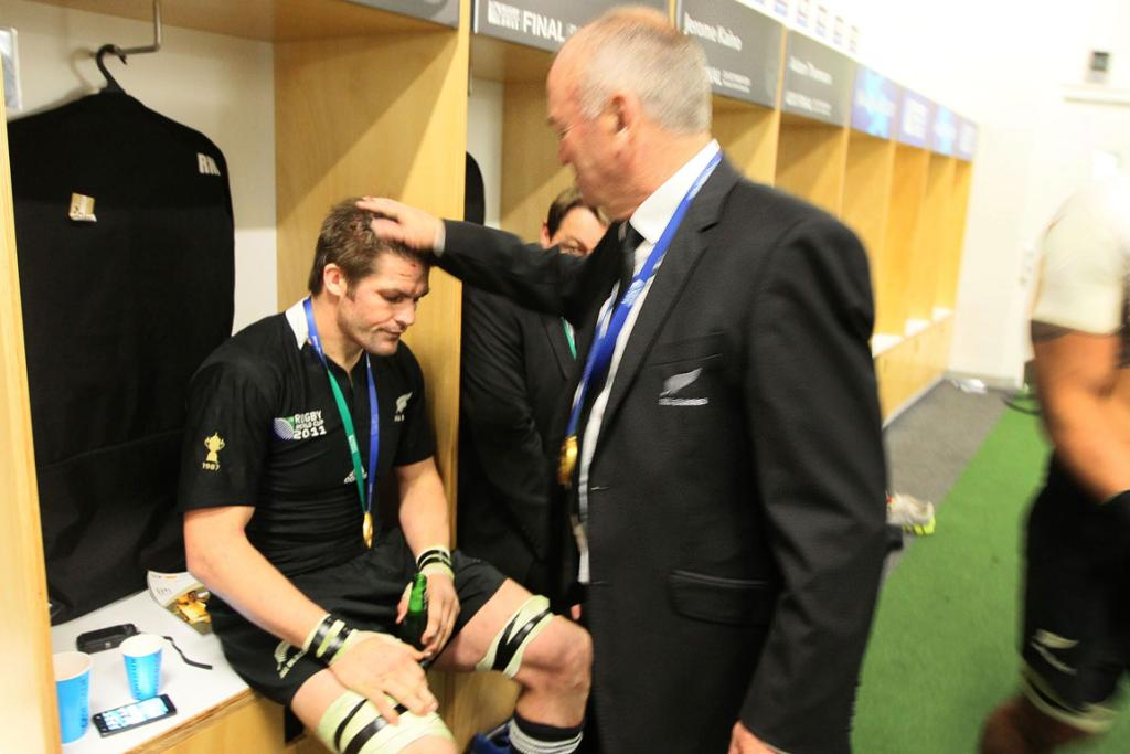 All Black captain Richie McCaw shares a moment with coach Graham Henry as he sits spent in the changing sheds after winning the Rugby World Cup 2011 final.