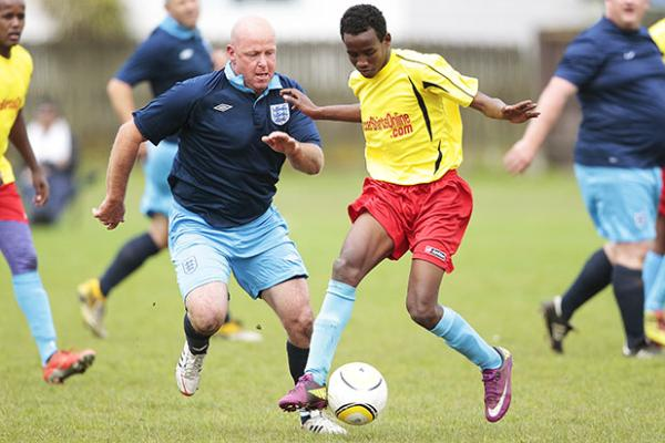 FANCY FEET: England Dad's Army player Darian Jamieson contests Jama Boss of Somalia Stars.
