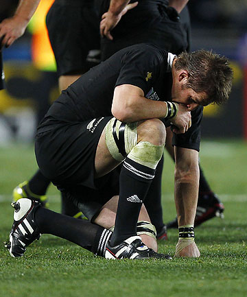 'ALL I FEEL IS RELIEF': All Blacks captain Richie McCaw sinks to one knee after the final whistle of the 2011 Rugby World Cup.