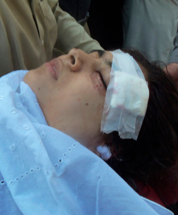 INJURED: Hospital staff assist Malala Yousufza after she was shot.