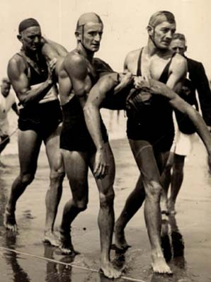 MUSCLE MAN: Ron Cooper, middle, during his surf life saving days at Piha.