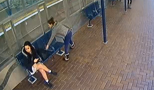 SNAPPED: CCTV footage has captured a group of three girls eyeing up another girl as she waits alone at Porirua train station.
