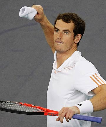 Andy Murray throws his wristband to fans  after beating Roger Federer in the singles semifinals of the Shanghai Masters.