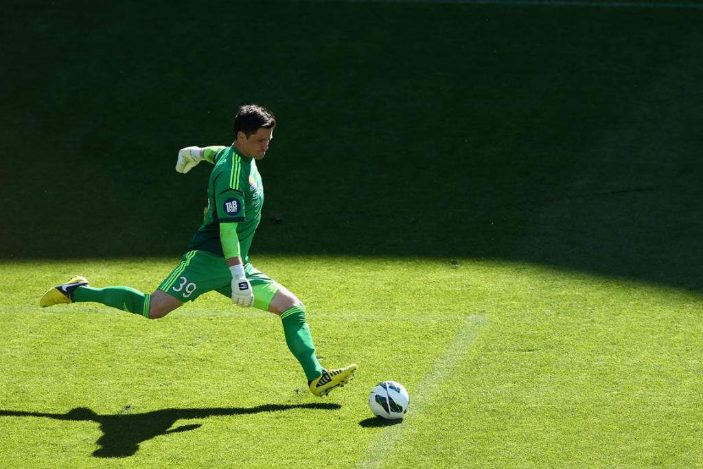 Phoenix goalkeeper Jacob Spoonley kicks the ball back into play during the round two A-League match between the Melbourne Heart and the Wellington Phoenix.