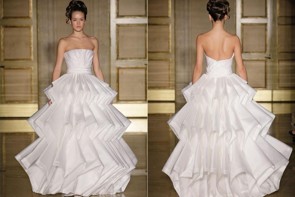 A model wears a distinctive dress from the Douglas Hannant Fall 2013 Bridal Collection.