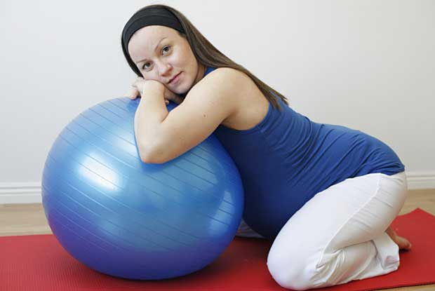Pregnant woman on swiss ball