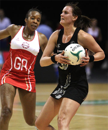 TIGHT TUSSLE: Leana De Bruin (right) of the Silver Ferns takes possession with England's Pamela Cookey in close attendance.