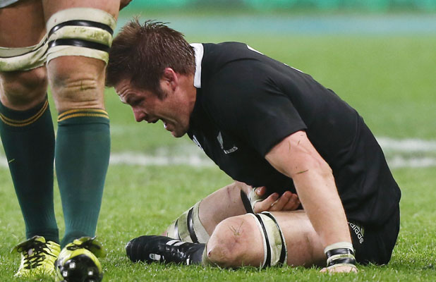 FEEL THE PAIN: Richie McCaw goes down injured during the match between the All Blacks and South Africa in Dunedin on September 15.