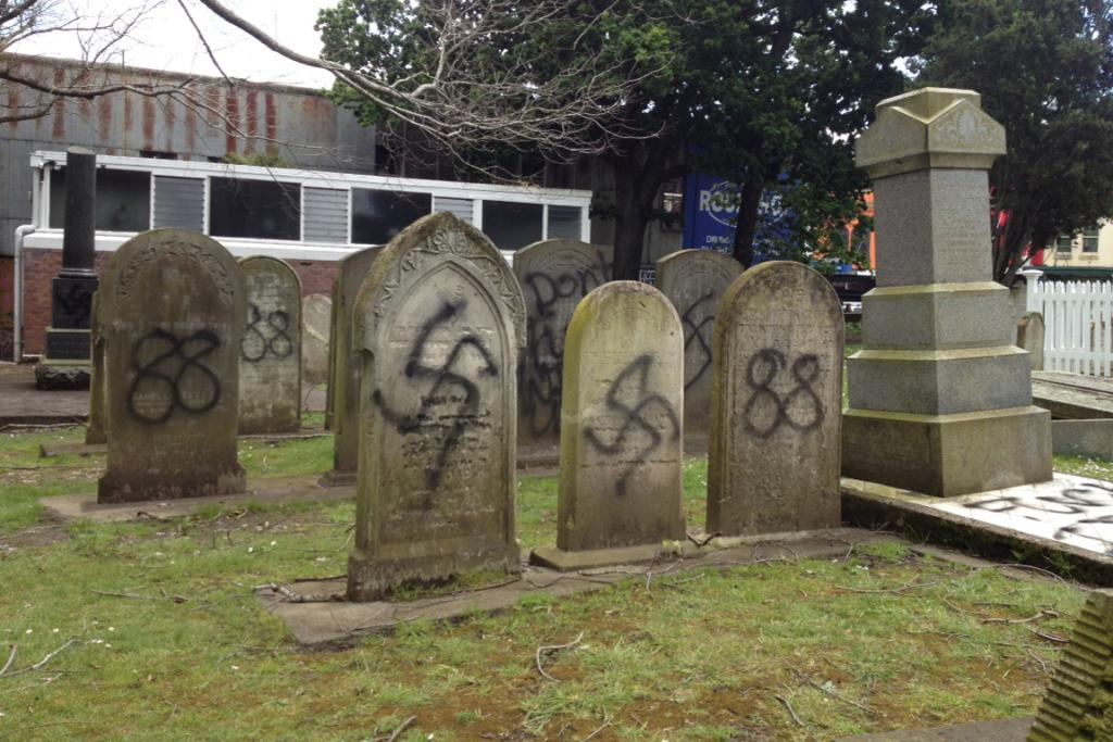 The defaced gravestones in the Auckland cemetery.