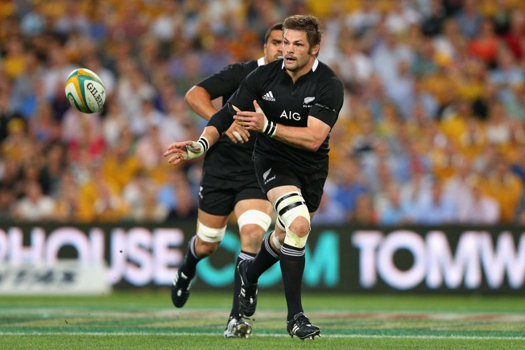 Richie McCaw looks to spread the ball wide for the All Blacks.