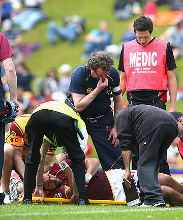 Hoani MacDonald is treated on the field during the ITM Cup Championship Semifinal match.