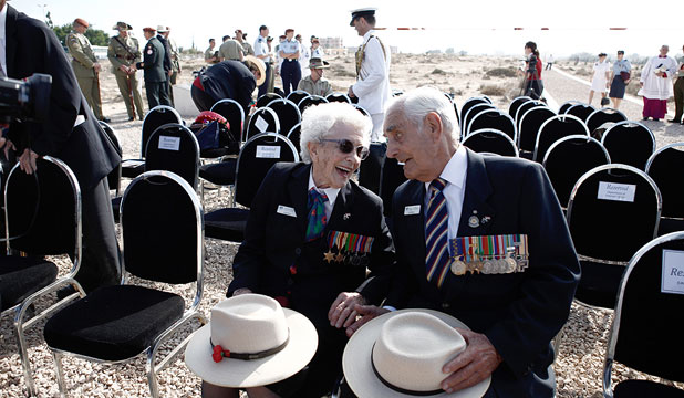 WAR STORIES: Veterans Jean Parry, 93, and Joe Madeley, 92, share memories during commemorations for the 70th anniversary of the Second Battle of El Alamein in El Alamein, Egypt.