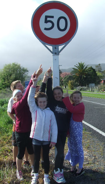 Slow down: Te Horo School students with the new 50kmh road sign they instigated on School Rd, from left Jonathon Walker, Emma Joss, Patrick Joss, Paige Cull, Peyton Morete and Lani Gray.