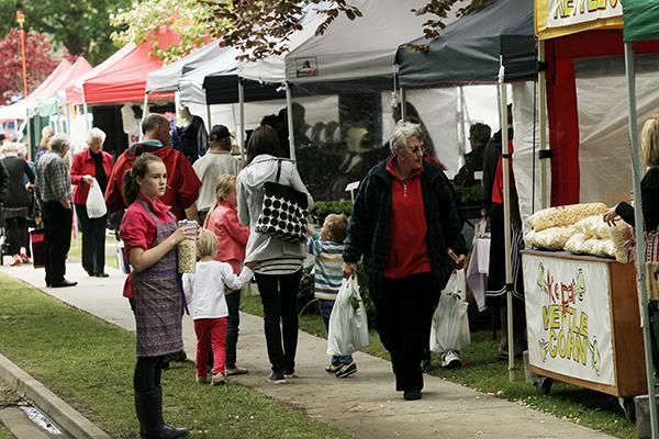 TENT ROW: More than 100 stalls offering fresh produce and local craft made for a special Labour Day outing.
