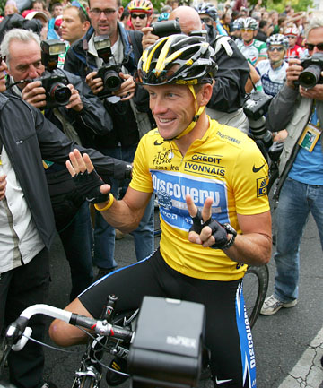HERO TO ZERO: Lance Armstrong after winning the 2005 Tour de France. He has now been stripped of all seven of his titles.