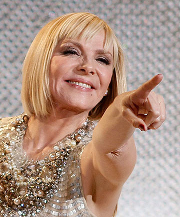 MOVING ON: Kim Cattrall is in the running for the role of mysterious older woman Elena Lincoln in Fifty Shades of Greu.
