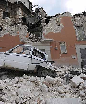 "A car in the rubble of the provincial government headquarters, ""Palazzio del Governo"", on the Abruzzo capital L'Aquila after the April, 2009 earthquake."