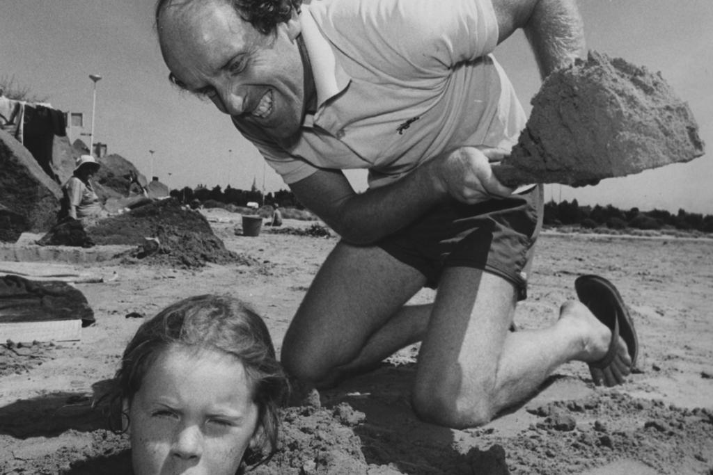 """BEACH FUN: We received this cheeky response from Brendan Murphy, who admitted he's the man pictured at Caroline Bay with his daughter, Natasha Hanson, who now lives in the United States with her husband and baby: """"The photograph shows my identical twin brother - who obviously has more hair than me – down at the Bay happily burying one of his children in the sand ... on that particular day, along came the Herald photographer who thought we should dramatise the situation for interest. The child was to look unhappy/worried whilst I was to be evilly covering her in. The photograph, published about 25 years ago, also showed the mother's foot hovering over the child holding her down. This outrageous photograph drew a letter to the editor [in response] questioning our suitability and our responsibilities as parents. Perhaps this was the very beginning of the age of political correctness. I like to think so."""""""