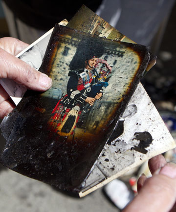 IRREPLACEABLE: Some of the photos damaged in a deliberately-lit blaze in Lorna's garage. Others were not salvageable. The arson was one of three in Canterbury early on Sunday. They are not believed to be linked.