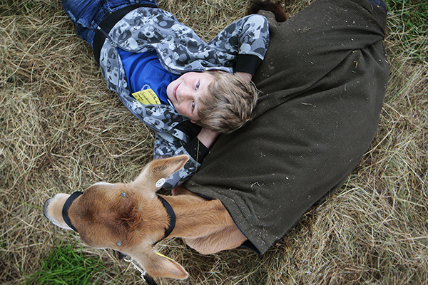 KICKING BACK: Josh Gurnell, 7, with Fudge.