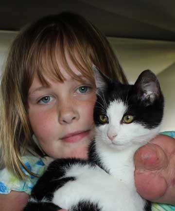 UNCONDITIONAL LOVE: Charlotte Cleverley-Bisman with her new cat Multy Salty from the SPCA.