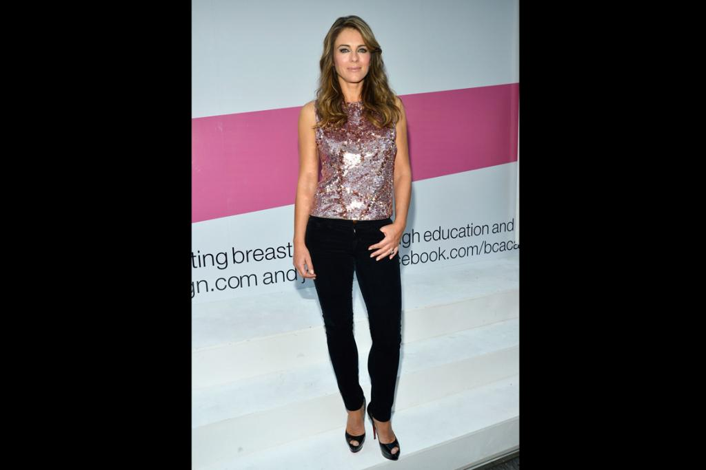 Liz Hurley begins the pink challenge at the launch of the Estee Lauder Breast Cancer Awareness Campaign in New York City at the beginning of October.