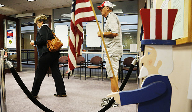 GETTING IN EARLY: Voters arrive to complete in-person absentee voting at the Fairfax County Governmental Center in Fairfax, Virginia.