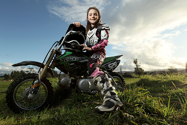 ALL DRESSED UP: Nikita Goodwin, 8, who recently took the honours at a ''mini'' motocross event in Auckland. She was made to work for her victory, but said ''it wasn't really easy''.