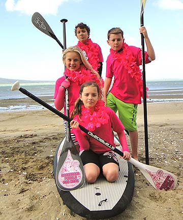 STANDING UP: The Centre of Attention paddleboard team will compete in the Paddle For Hope breast cancer awareness competition. Pictured, front to back, are: Amy Byrnand, 11, Claudia Lyons, 10, Quinn Jackson, 11, and Dominic Stuart, 10.