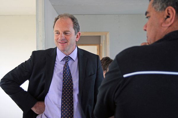Meet and greet: Labour leader David Shearer talks training on Thursday at a house built by WelTec carpentry certificate students on an Otaki lot. In the foreground is course tutor Richard Carter.