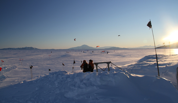 ON ICE: Antarctic staff kite surfing on the ice on their day off.