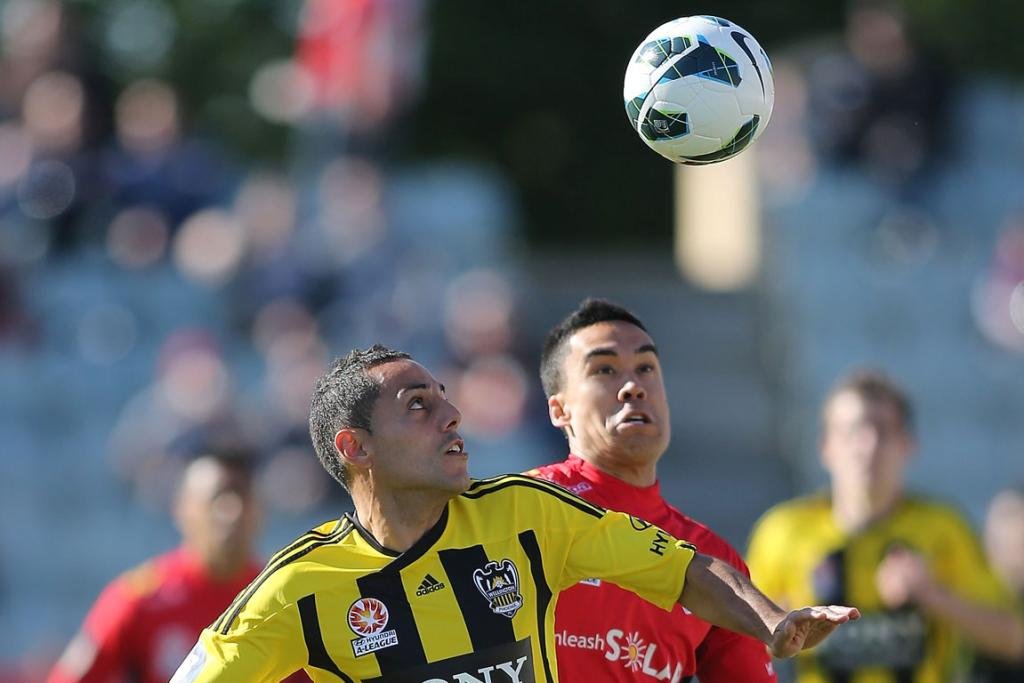 Leo Bertos (L) of Wellington competes with Iain Ramsay of Adelaide.