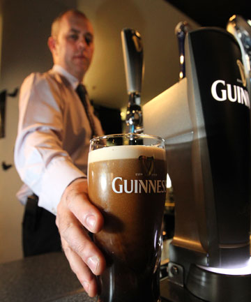 POURING SKILLS: Nick Madden, assistant manager of the Kelvin Hotel, in Invercargill, demonstrates how to pour the perfect pint of Guinness.
