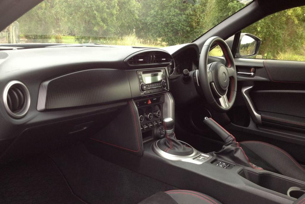 Cabin environment: Plastics, bad. Alcantara upholstery and driving position, good.