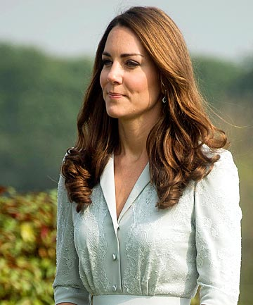 ON TOUR: The duchess in Singapore, shortly after the topless photos were taken.