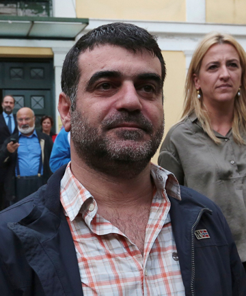 ON BAIL: Greek editor Costas Vaxevanis leaves a prosecutor's office in Athens.