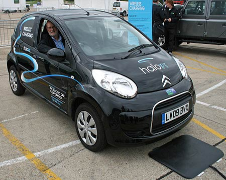 EV makers hope their cars will be more attractive if they can be parked over a charging pad, rather than actually plugged in when requiring a charge.