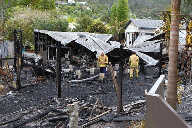 SUSPICIOUS FIRE: Firefighters look around at the remains of the Cove restaurant in Hahei which was destroyed in an overnight fire.