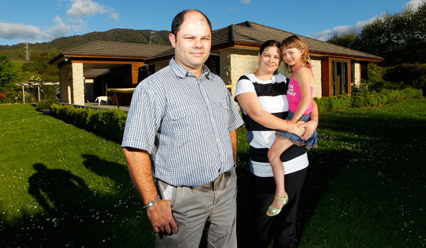 HOME SEEKERS: Andre and Madeleine Alberts with their daughter Chandrae, 8, outside their rented home in Waikanae.