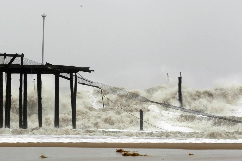 A wall of water batters what remains of the fishing pier in Ocean City, Maryland as Hurricane Sandy intensifies.