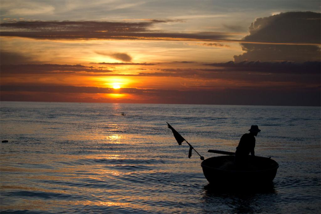 Fisherman at sunrise in Hoi An, Vietnam.